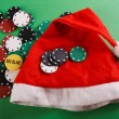 Casino gambling chips and a cap of Santa Claus — Stock Photo #18045133