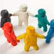Human figures from clay stand in a circle — Stock Photo