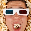 Young guy in the popcorn — Stock Photo #18045185