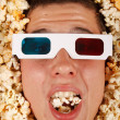 Young guy in the popcorn — Stockfoto #18045185