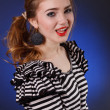 Beautiful young girl in a striped blouse — Stock Photo #18045375