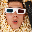 Young guy in the popcorn — Stockfoto #18045407