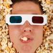 Young guy in the popcorn — Stock Photo #18045455