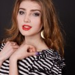 Beautiful young girl in a striped blouse — Stockfoto #18045541