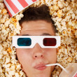 Young guy in the popcorn — Stockfoto #18045573