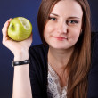 Portrait of an attractive young girl with an apple — Foto Stock