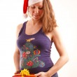 Pregnant woman in Christmas hat — Stock Photo