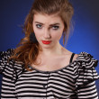 Beautiful young girl in a striped blouse — 图库照片