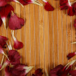 Wooden background with petals — ストック写真