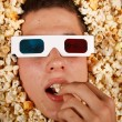 Young guy in the popcorn — Stock Photo #18045969