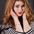 Beautiful young girl in a striped blouse — ストック写真