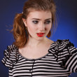 Beautiful young girl in a striped blouse — Stock Photo #18046079