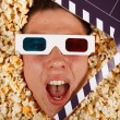 Young guy in the popcorn — Stock Photo
