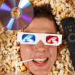 Young guy in the popcorn — Stock Photo #18046245