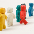 Plasticine little men stand in a row — Stock Photo
