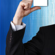 Business man handing a blank business card — Stock Photo
