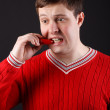 Young guy eats pepper — Stock Photo #18046689