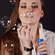 Girl blow bubbles — Stock Photo #18046783