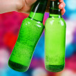 Green bottle. disco background — Stock Photo #18046799