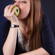 Portrait of an attractive young girl with an apple — Stock Photo #18046869