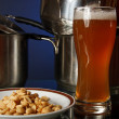 A glass of beer in the kitchen — Stock Photo
