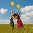 Happy young women and colorful balloons — Stock Photo #18046981