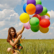 Happy young woman and colorful balloons — Stock fotografie #18047005