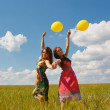 Happy young women and colorful balloons — Stock Photo #18047095
