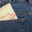 Sticker in your pocket jeans. The text - Kiss me. — Stock Photo