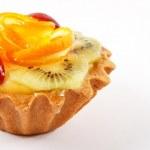 Sweet cake with fruits on white background — Stock Photo #18047111