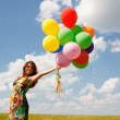Happy young woman and colorful balloons — Stock fotografie #18047113