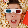 Young guy in the popcorn — Stockfoto