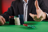 Businessman playing poker — Stock Photo