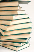 Pile of books on white background — Stock Photo