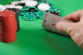 Businessman playing poker — Stock Photo