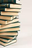 Pile of books on white background — Stock Photo