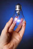 Light bulb in his hand — Stock Photo