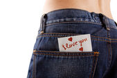 Sticker in your pocket jeans. The text - I love you. — Stock Photo
