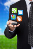 Businessman holding mobile phone — Stock Photo