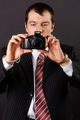 Man with a camera — Stock Photo