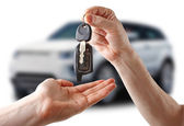τα κλειδιά στο αυτοκίνητο. λευκό φόντο. — Φωτογραφία Αρχείου