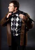 Young businessman in a sheepskin coat — Stock Photo