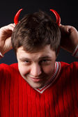 Guy with the horns of the pepper — Stock Photo