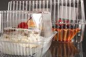 Fresh cake in plastic packaging — Stock Photo