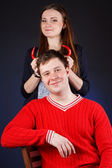 Beautiful girl with young man with red horns made of pepper — Foto Stock
