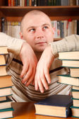 Man and books — Stock Photo