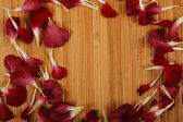 Wooden background with petals — Stock Photo