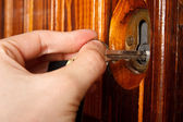 Open door with keys — Stock Photo
