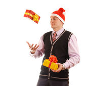 Young businessman in santa hat offering a gift to you — Stock Photo