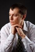 Young businessman thinking — Stock Photo